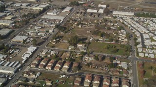 DCSF08_003 - Aerial stock footage of 5K Aerial Video Reverse view of tract homes in Hayward, California