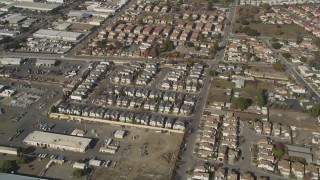 DCSF08_004 - Aerial stock footage of 5K Aerial Video Reverse view of tract homes, reveal office buildings, Hayward, California