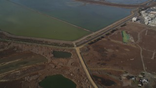 DCSF08_005 - Aerial stock footage of 5K Aerial Video Reverse view of sloughs in Union City, California