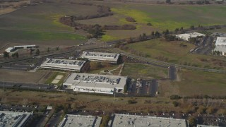 DCSF08_007 - Aerial stock footage of 5K Aerial Video Reverse view of business park office buildings in Newark, California