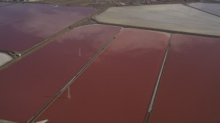 DCSF08_008 - Aerial stock footage of 5K Aerial Video Pan across salt marshes in Newark, California