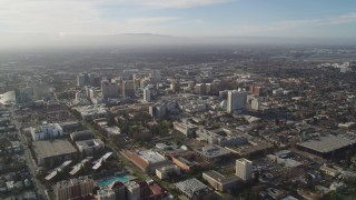 DCSF09_004 - Aerial stock footage of 5K Aerial Video Flyby San Jose State University, Downtown San Jose in the background, California