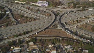 DCSF09_007 - Aerial stock footage of 5K Aerial Video Flying over freeway interchange, tilt to reveal Downtown San Jose, California