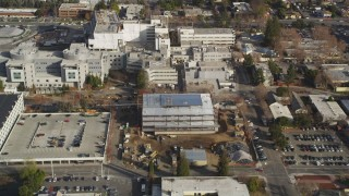 DCSF09_010 - Aerial stock footage of 5K Aerial Video Reverse view of suburban neighborhoods, reveal Santa Clara Valley Medical Center, San Jose, California