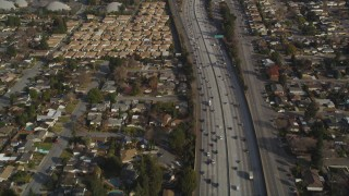 DCSF09_011 - Aerial stock footage of 5K Aerial Video Reverse view of light traffic on Interstate 280, San Jose, California