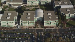 DCSF09_016 - Aerial stock footage of 5K Aerial Video Fly over parking lots and reveal Apple Headquarters, tilt to bird's eye view, Cupertino, California