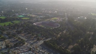 DCSF09_019 - Aerial stock footage of 5K Aerial Video Reverse view of Stanford Stadium, pan across campus of Stanford University, Stanford, California