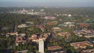 DCSF09_023 - Aerial stock footage of 5K Aerial Video Tilt and fly over Stanford University, reveal Hoover Tower, stadiums and fields, Stanford, California