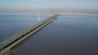 DCSF09_025 - Aerial stock footage of 5K Aerial Video Tilt from wetlands to reveal San Francisco Bay and Dumbarton Bridge, California