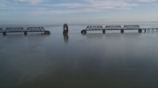 DCSF09_026 - Aerial stock footage of 5K Aerial Video Tilt from the bay to reveal and flyby the Dumbarton Rail Bridge in San Francisco Bay, California