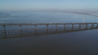 DCSF09_028 - Aerial stock footage of 5K Aerial Video Pan across light traffic on the Dumbarton Bridge, Fremont, California