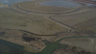DCSF09_031 - Aerial stock footage of 5K Aerial Video Flying away from marshland, Hayward, California