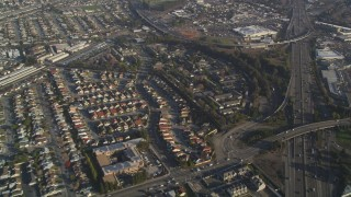 DCSF09_034 - Aerial stock footage of 5K Aerial Video Reverse view of residential neighborhoods by I-880, San Leandro, California