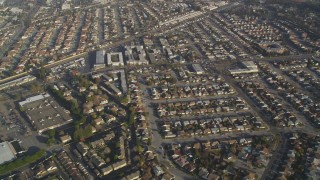 DCSF09_035 - Aerial stock footage of 5K Aerial Video Reverse view of residential neighborhoods and shopping centers, San Leandro, California