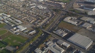 DCSF09_036 - Aerial stock footage of 5K Aerial Video Reverse view of I-880, John Muir Middle School, and warehouse buildings in San Leandro, California