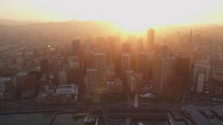 DCSF10_009 - Aerial stock footage of 5K Aerial Video Downtown skyscrapers and the Ferry Building, San Francisco, California, sunset