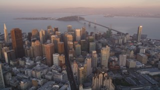 DCSF10_013 - Aerial stock footage of 5K Aerial Video Reverse view of Downtown San Francisco, California, sunset, pan across cityscape