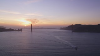 DCSF10_025 - Aerial stock footage of 5K Aerial Video Setting sun behind the Golden Gate Bridge, San Francisco, California, sunset