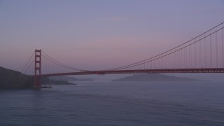 DCSF10_030 - Aerial stock footage of 5K Aerial Video Fly low by the Golden Gate Bridge and pan across the span, San Francisco, California, twilight