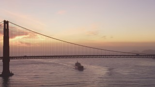 DCSF10_042 - Aerial stock footage of 5K Aerial Video View of an oil tanker approaching the Golden Gate Bridge, San Francisco, California, twilight