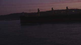 DCSF10_045 - Aerial stock footage of 5K Aerial Video Flyby an oil tanker, reveal Golden Gate Bridge, San Francisco, California, twilight