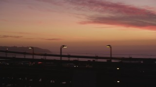 DCSF10_049 - Aerial stock footage of 5K Aerial Video Tracking cars on the Golden Gate Bridge, and fly away to a wider view, San Francisco, California, twilight