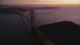 DCSF10_050 - Aerial stock footage of 5K Aerial Video Flyby heavy traffic crossing the Golden Gate Bridge, San Francisco, California, twilight