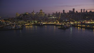 DCSF10_056 - Aerial stock footage of 5K Aerial Video Flyby Fisherman's Wharf and downtown skyline, reveal Pier 39, North Beach, San Francisco, California, twilight