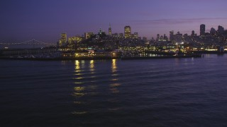 DCSF10_058 - Aerial stock footage of 5K Aerial Video Approach Pier 39 from the San Francisco Bay, San Francisco, California, night
