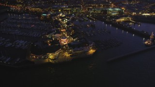 DCSF10_059 - Aerial stock footage of 5K Aerial Video Tilt to a bird's eye view of Pier 39, decorated for Christmas, San Francisco, California, night