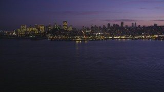 DCSF10_060 - Aerial stock footage of 5K Aerial Video Low altitude approach to Pier 39 and skyline of Downtown San Francisco, California, twilight