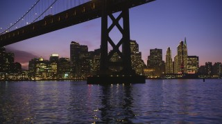 DCSF10_066 - Aerial stock footage of 5K Aerial Video Fly under Bay Bridge near Downtown San Francisco, California, twilight