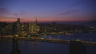 DCSF10_072 - Aerial stock footage of 5K Aerial Video Flying by the Bay Bridge with San Francisco skyline in the background, California, night
