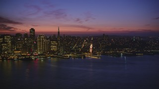 DCSF10_073 - Aerial stock footage of 5K Aerial Video Pan across Downtown San Francisco, California, to reveal heavy traffic on the Bay Bridge, night