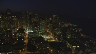 DCSF10_075 - Aerial stock footage of 5K Aerial Video Heavy traffic on streets through downtown, reveal One Rincon Hill skyscraper, San Francisco, California, night