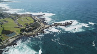 DCSF11_003 - Aerial stock footage of 5K Aerial Video of Pacific Grove Municipal Golf Links and waves crashing on the coast by Ocean View Boulevard, Pacific Grove, California