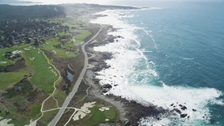 DCSF11_005 - Aerial stock footage of 5K Aerial Video Tilt from kelp to reveal Pacific Grove Municipal Golf Links, and Ocean View Boulevard on the coast, Pacific Grove, California