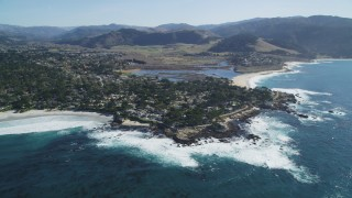 DCSF11_009 - Aerial stock footage of 5K Aerial Video Tilt from the ocean to reveal a coastal residential neighborhood in Carmel, California