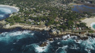 DCSF11_011 - Aerial stock footage of 5K Aerial Video Flyby a coastal neighborhood, waves crashing into rocks, Carmel, California