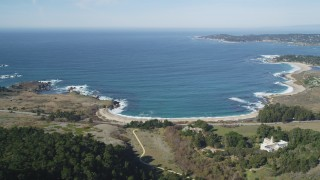 DCSF11_012 - Aerial stock footage of 5K Aerial Video Approach Carmel Bay and beach by Highway 1 by Carmelite Monastery, Carmel, California