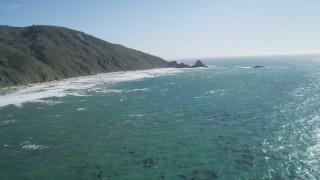 DCSF11_030 - Aerial stock footage of 5K Aerial Video Tilt from ocean kelp to reveal steep cliffs, Big Sur, California