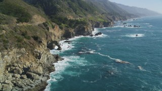 DCSF11_037 - Aerial stock footage of 5K Aerial Video Following the coastline, waves crashing into rocks, Big Sur, California