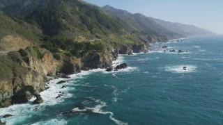 DCSF11_037 - Aerial stock footage of 5K Aerial Video Following the coastline, waves crashing into rocks, Big Sur, California