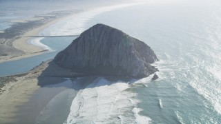 DCSF11_045 - Aerial stock footage of 5K Aerial Video Flying by Morro Rock in Morro Bay, California