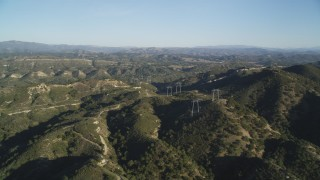 DCSF12_002 - Aerial stock footage of 5K Aerial Video Approach power lines atop hills, San Luis Obispo County, California