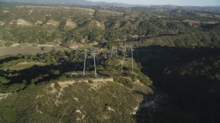 DCSF12_003 - Aerial stock footage of 5K Aerial Video Following a row of power lines over hills, San Luis Obispo County, California