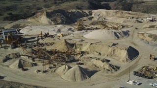 DFKSF01_003 - 5K stock footage aerial video of flying by industrial equipment at a quarry, Simi Valley, California