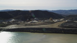 DFKSF01_005 - 5K stock footage aerial video orbit a quarry and industrial equipment, Simi Valley, California