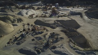 DFKSF01_006 - 5K stock footage aerial video of flying by a working quarry, industrial equipment, Simi Valley, California