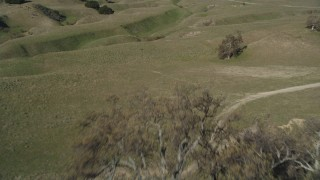DFKSF01_008 - 5K stock footage aerial video of approaching and flying over an isolated ranch house and a barn, Simi Valley, California